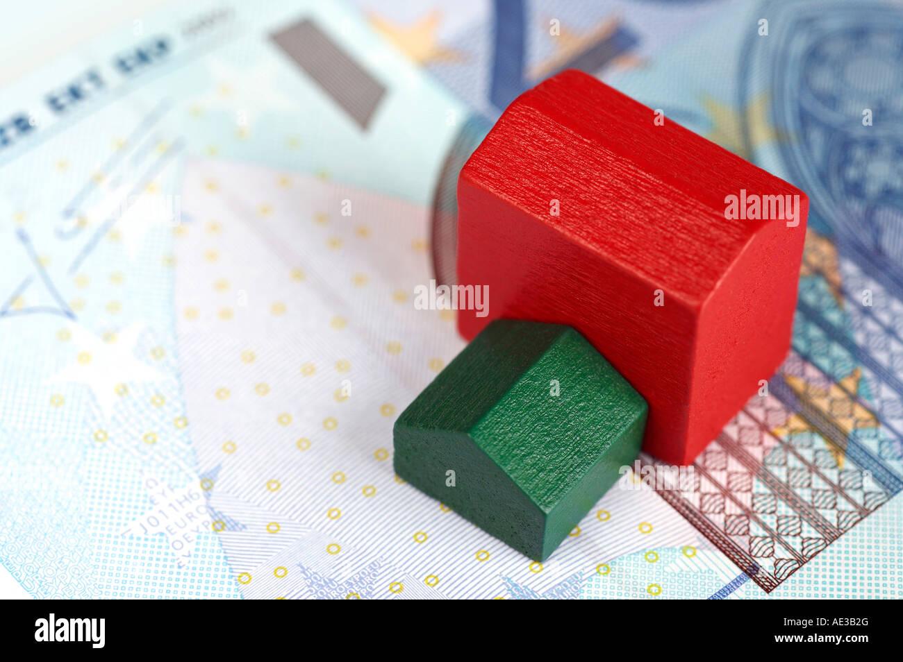 Monopoly houses on a twenty Euro banknote - Stock Image