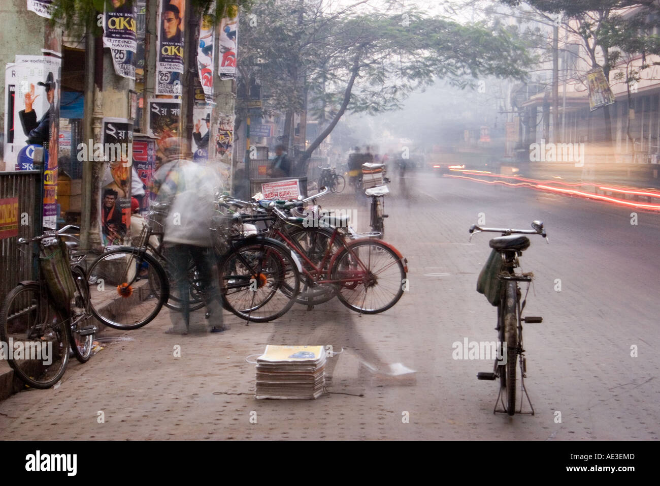 Newspaper delivery in Calcautta Kolkata India at dawn Stock