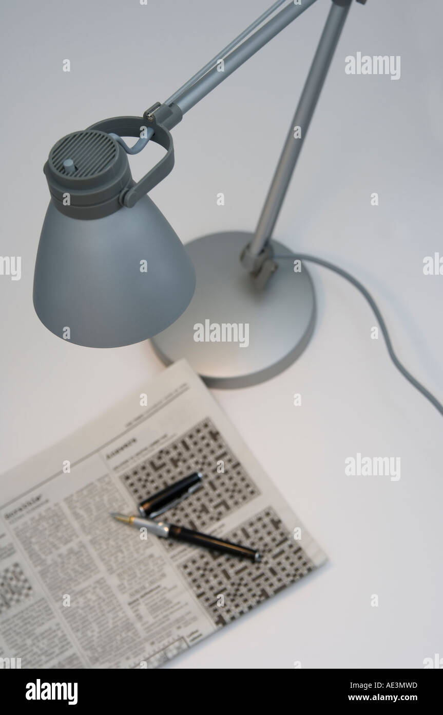 Remarkable Desktop Lamp And Crossword Stock Photo 7747228 Alamy Download Free Architecture Designs Rallybritishbridgeorg