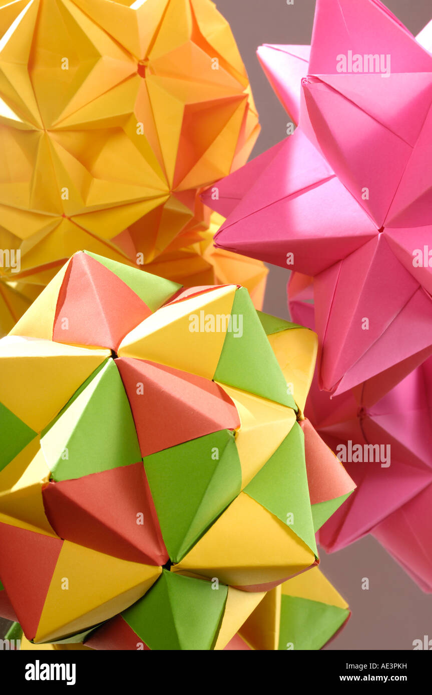 Colorful bright Origami abstract decorative paper figures polyhedrons - Stock Image