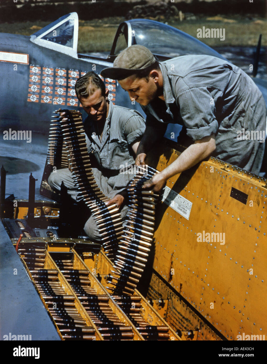 World War Two Crew loading ammunition into the wing of a P 47 Thunderbolt - Stock Image