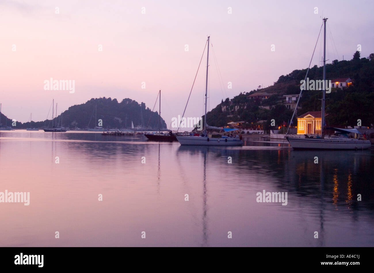 The harbour at Lakka at dusk, Paxos, Ionian Islands, Greek Islands, Greece, Europe - Stock Image