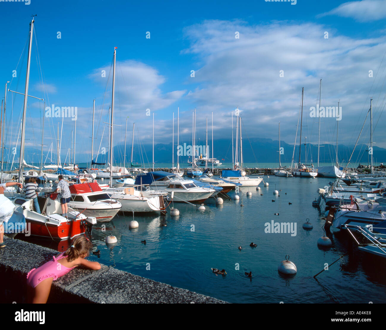 switzerland lake leman Lutry yachting harbour little girl - Stock Image