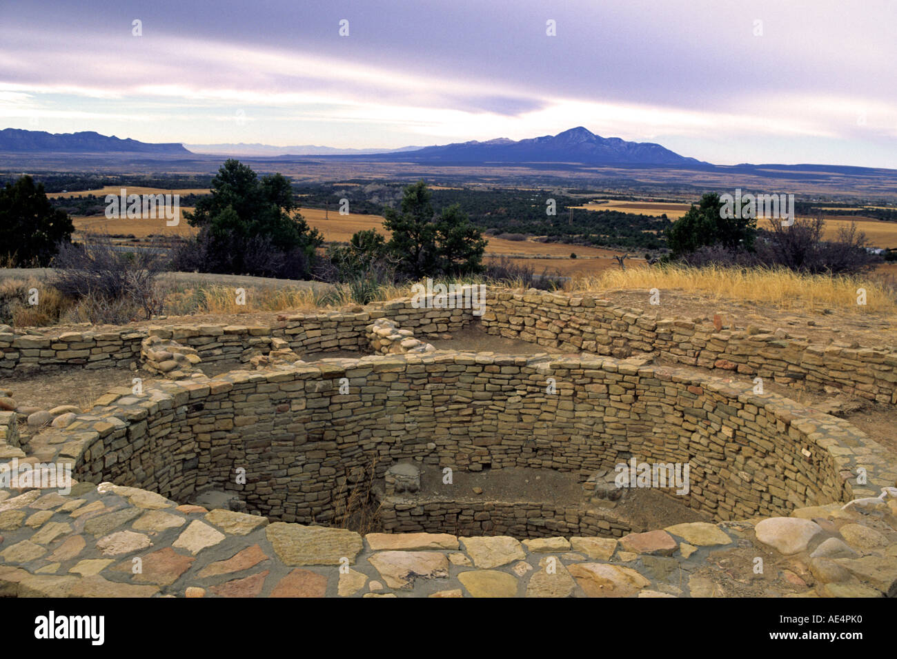 Kiva of Escalante Pueblo overlooks Sleeping Ute Mountain at Anasazi Heritage Center, southwest Colorado. - Stock Image