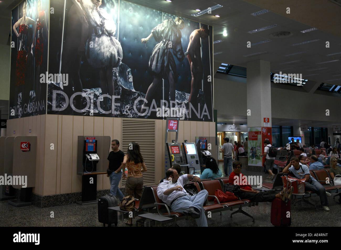 Dolce Gabbana Advert Departure Lounge Milan Airport Italy - Stock Image
