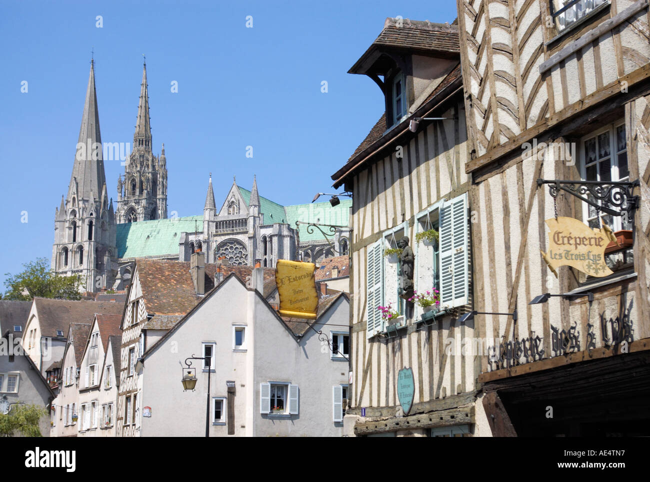 Cathedrale Notre Dame de Chartres the Cathedral of Our Lady of Chartres France wood framed buildings on Rue de Bourg - Stock Image