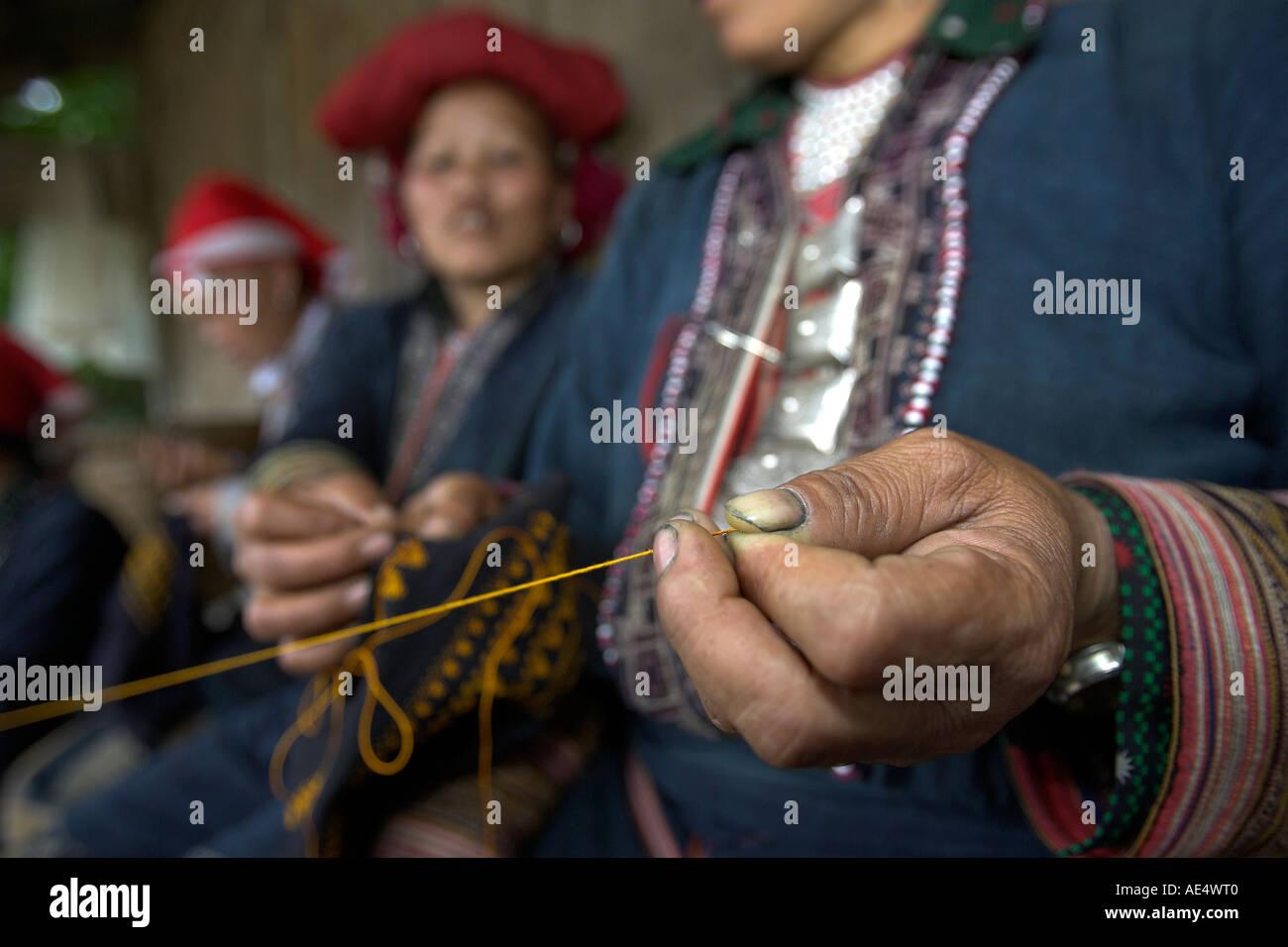 Red Zao hilltribe woman twisting yarn Ta Phin village near Sapa north Vietnam Stock Photo