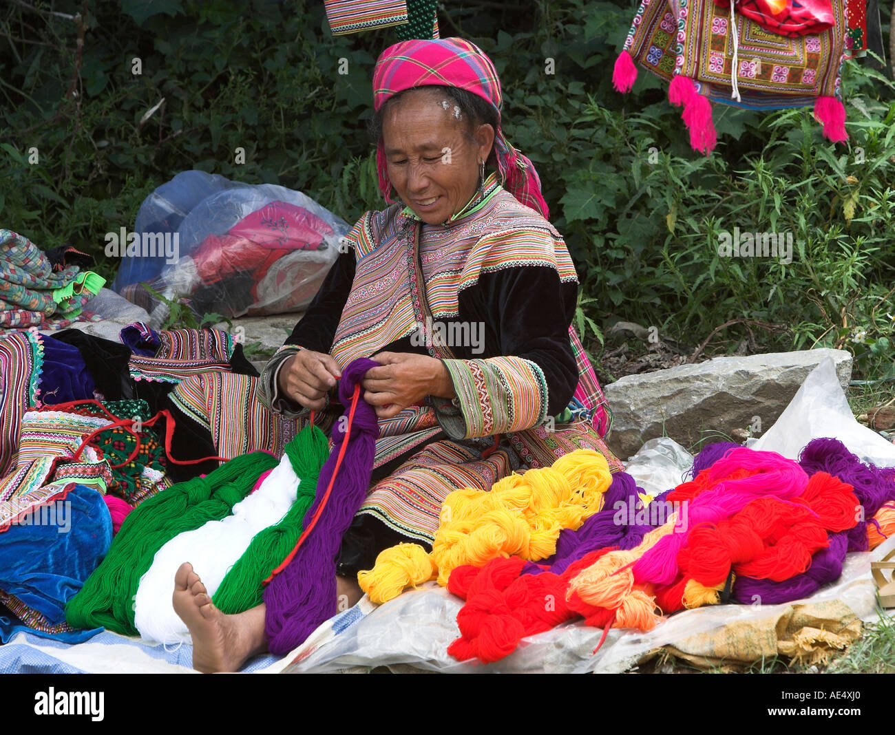 Woman sorts coloured yarns Bac Ha hilltribe market known for colourful Flower Hmong traders north Vietnam Stock Photo