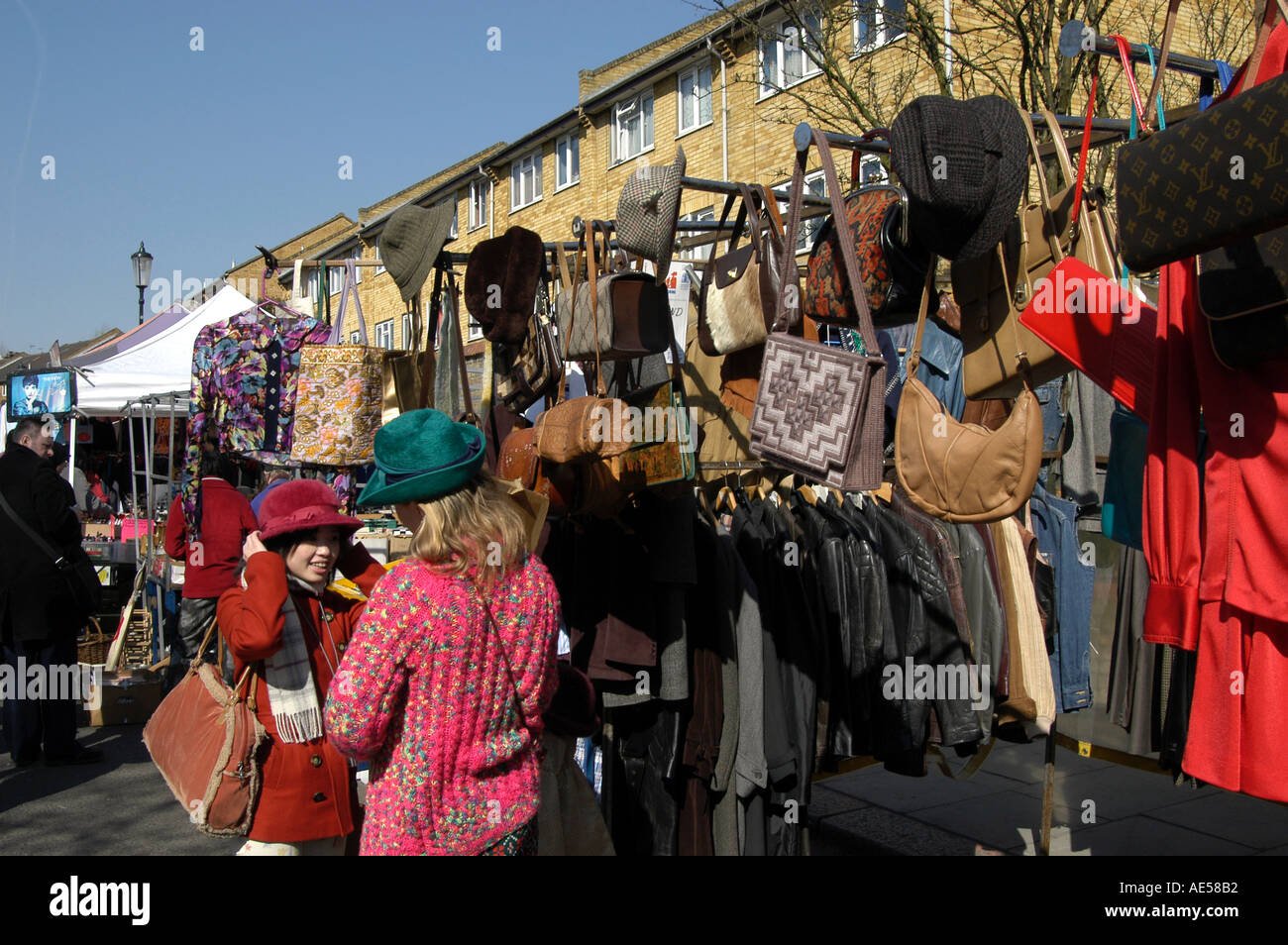 Hats and bags for sale on market stall on Portobello Road market, Notting Hill, London, England, UK Stock Photo