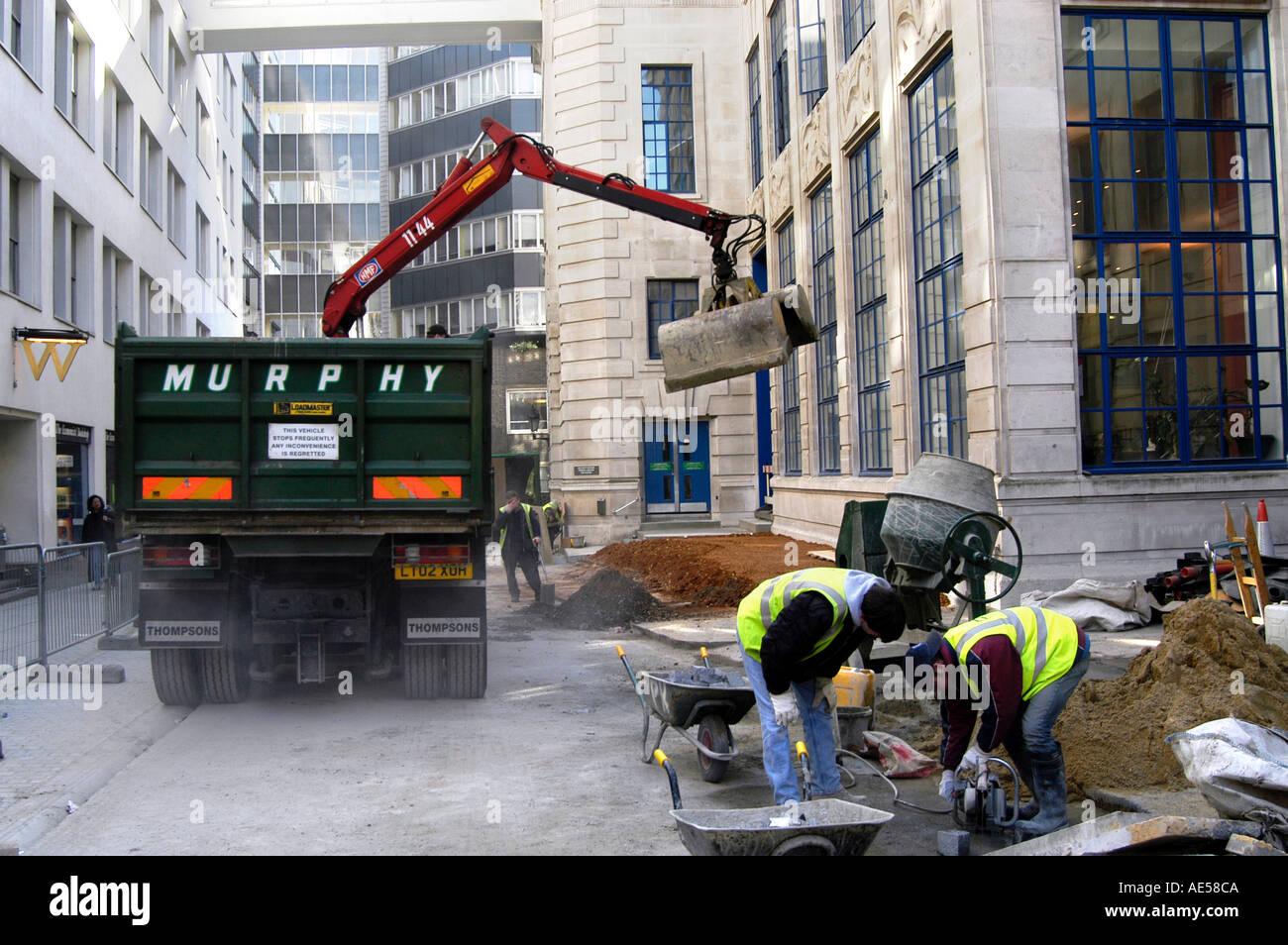 Murphy workmen on public road works in London England UK - Stock Image