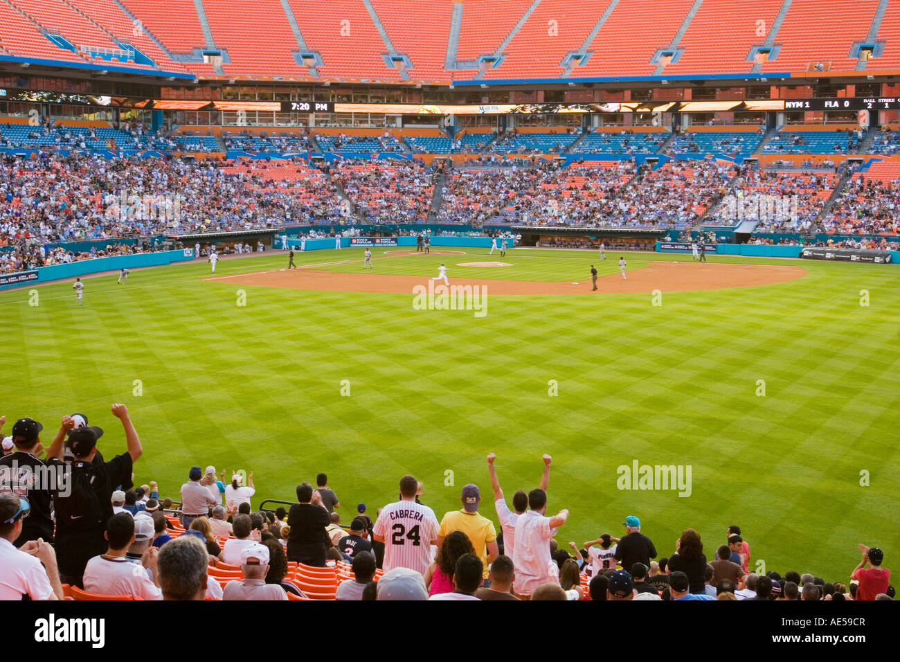 Crowd in the outfield stands at Dolphin Stadium standing and cheering their team - Stock Image