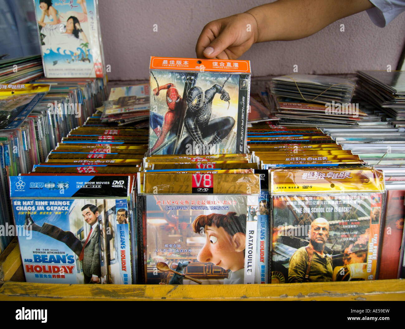 Counterfeit DVD movies for sale on a stall on Shanghai Street 2007 - Stock Image