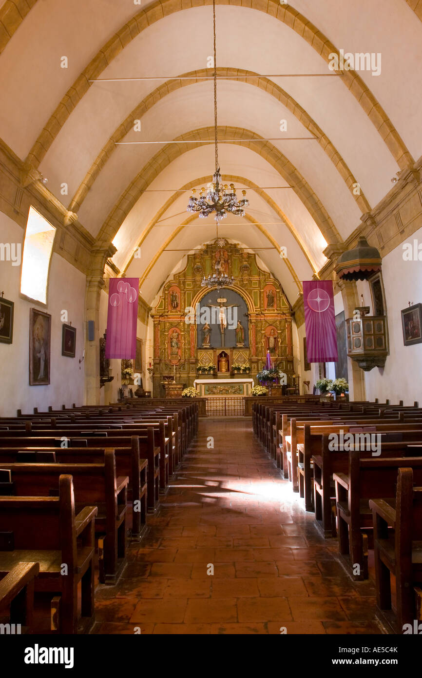 Nave of the Carmel Mission Basilica looking down the aisle of pews to Stock  Photo - Alamy