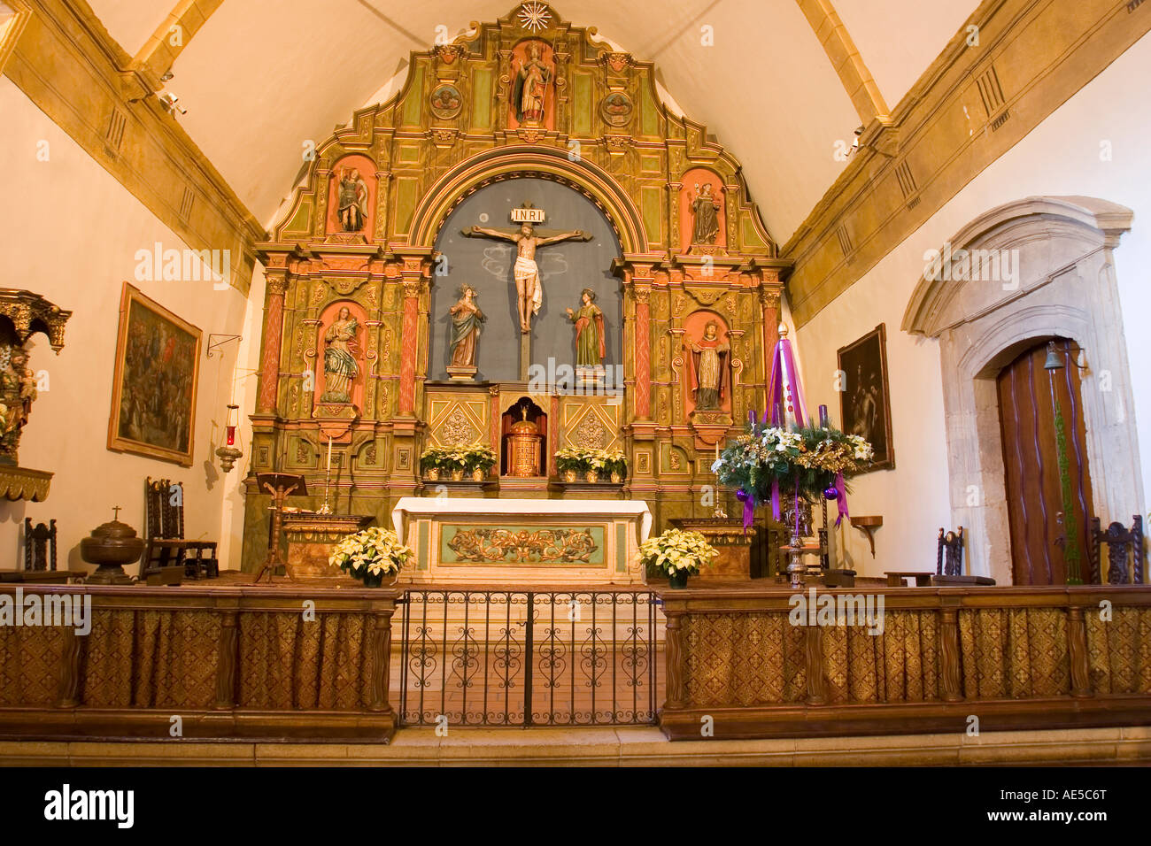 Front chancel and altar of the Carmel Mission church with railing in Carmel Mission Basilica church - Stock Image