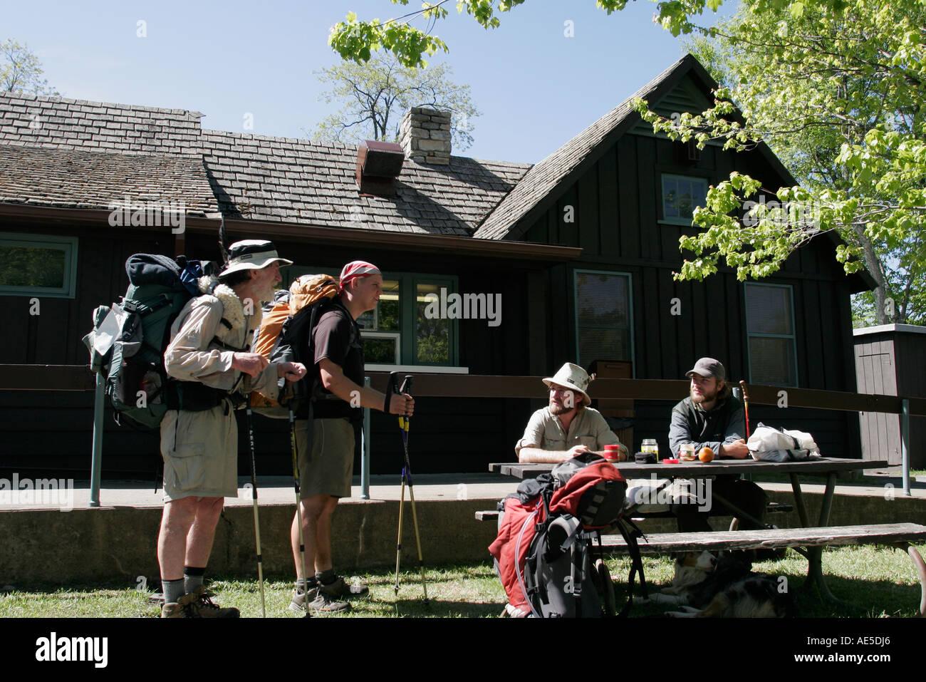 Virginia VA South Shenandoah National Park mile marker 24 Elkwallow camp store hikers eating American Americans VA060524021 Stock Photo