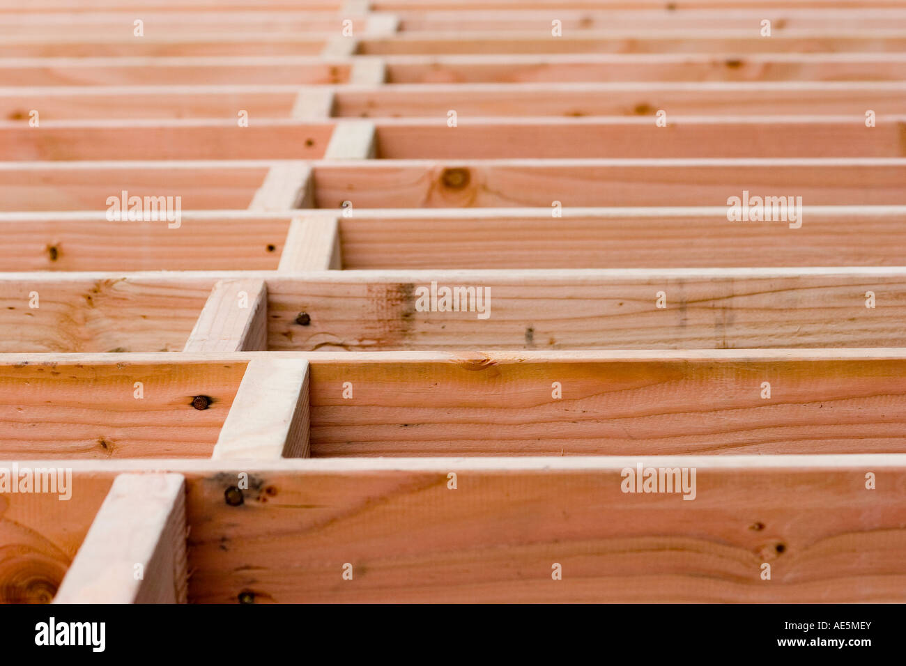 Wood Blocking In A Staggered Pattern Between Floor Joists At A