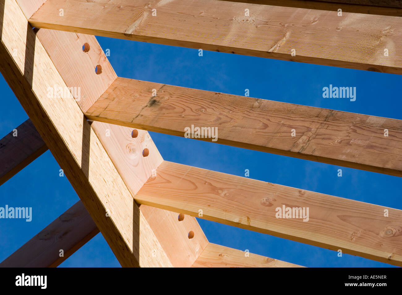 Roof rafters resting on ridge beam of room under