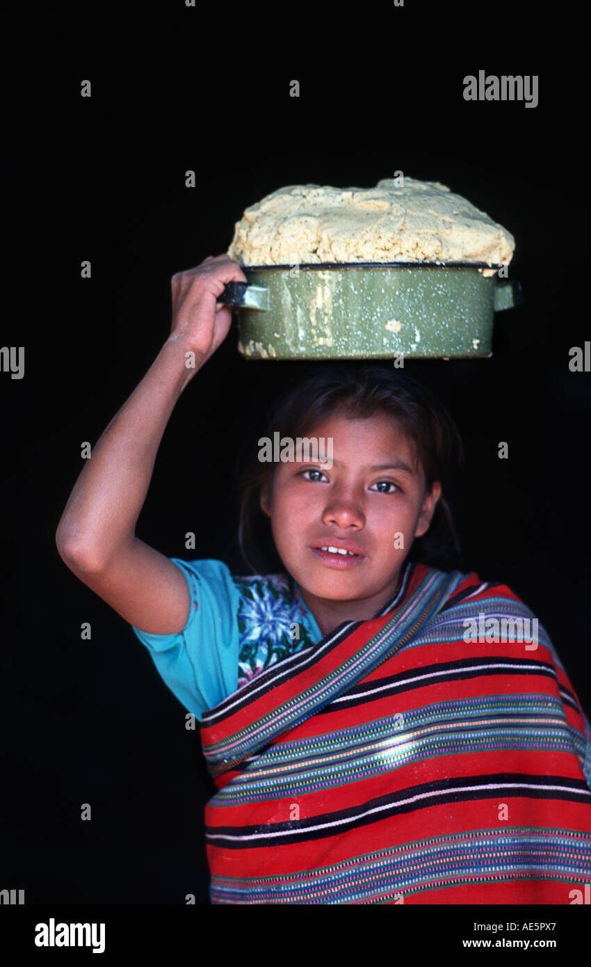Girl from Cotzal with container of maize meal balanced on her head El Quiche Guatemala - Stock Image