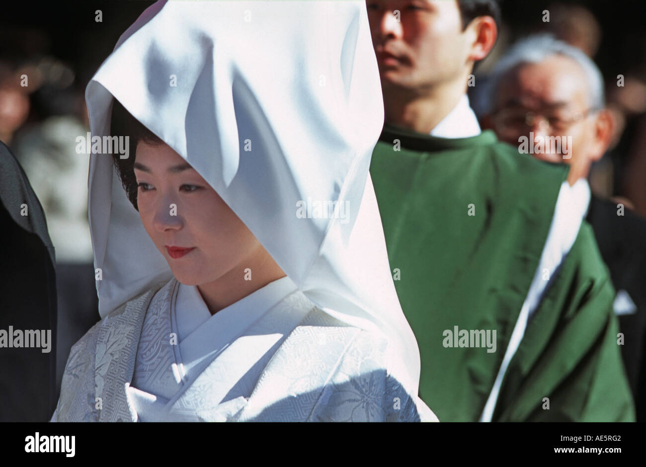 Japanese bride in her wedding dress and headcloth Meiji Shrine in Central Tokyo New Year Japan - Stock Image
