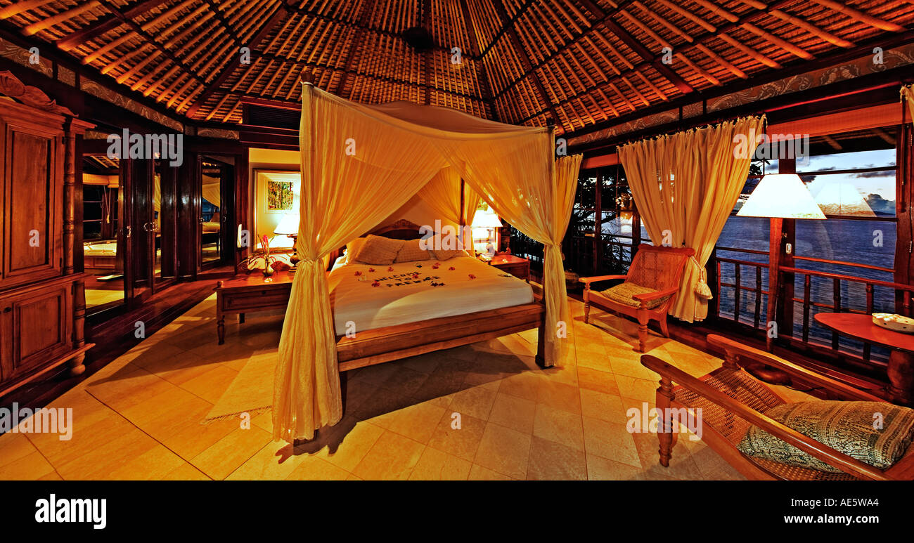 Bedroom interior of exclusive luxury villa Fregate Island Hotel Seychelles Property released - Stock Image