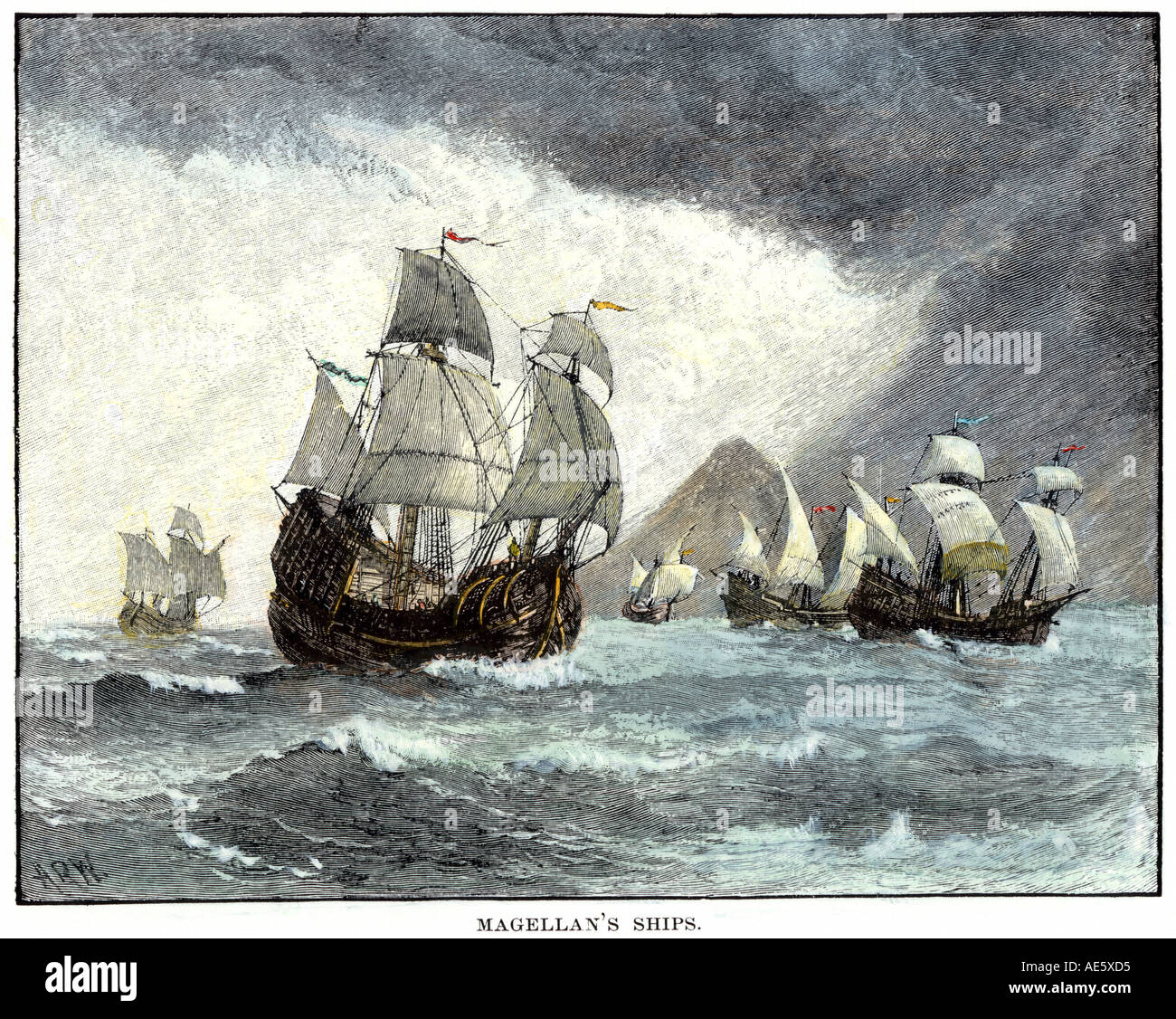 Ships of Ferdinand Magellan rounding Tierra del Fuego to circumnavigate the earth 1519 to 1521. Hand-colored woodcut - Stock Image