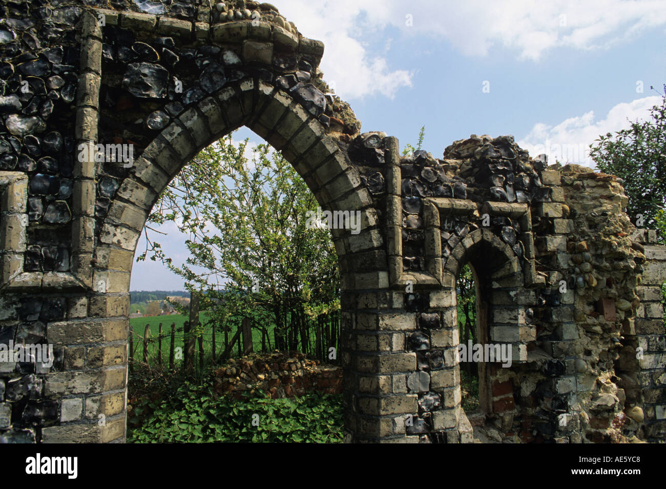 Small garden folly in mock Gothic style in the grounds of The Crown pub Stoke by Nayland Suffolk - Stock Image