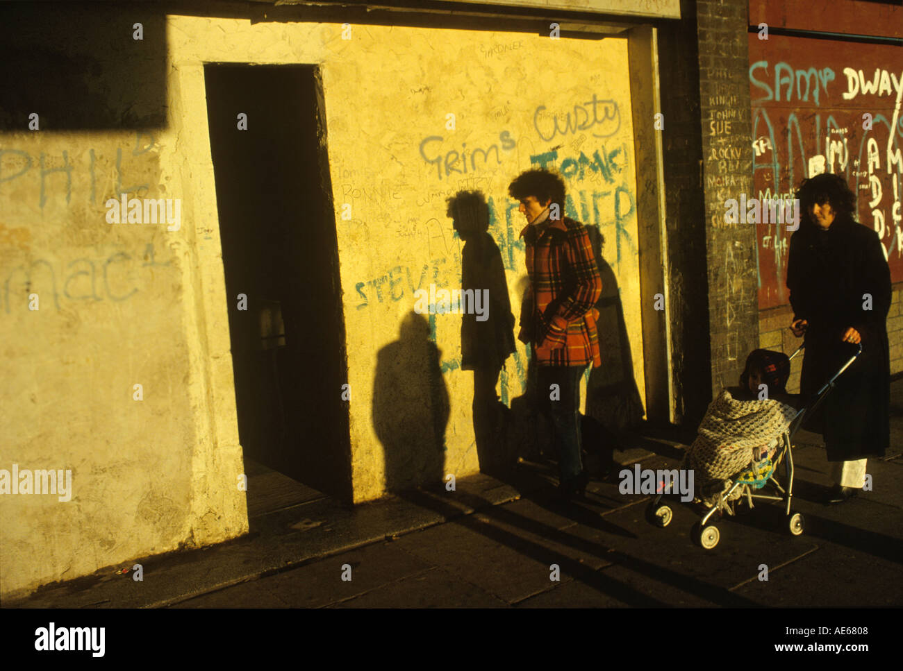 Protected shop - concrete wall where window once was narrow opening local corner store Liverpool Lancashire 1980s 80s Uk HOMER SYKES - Stock Image