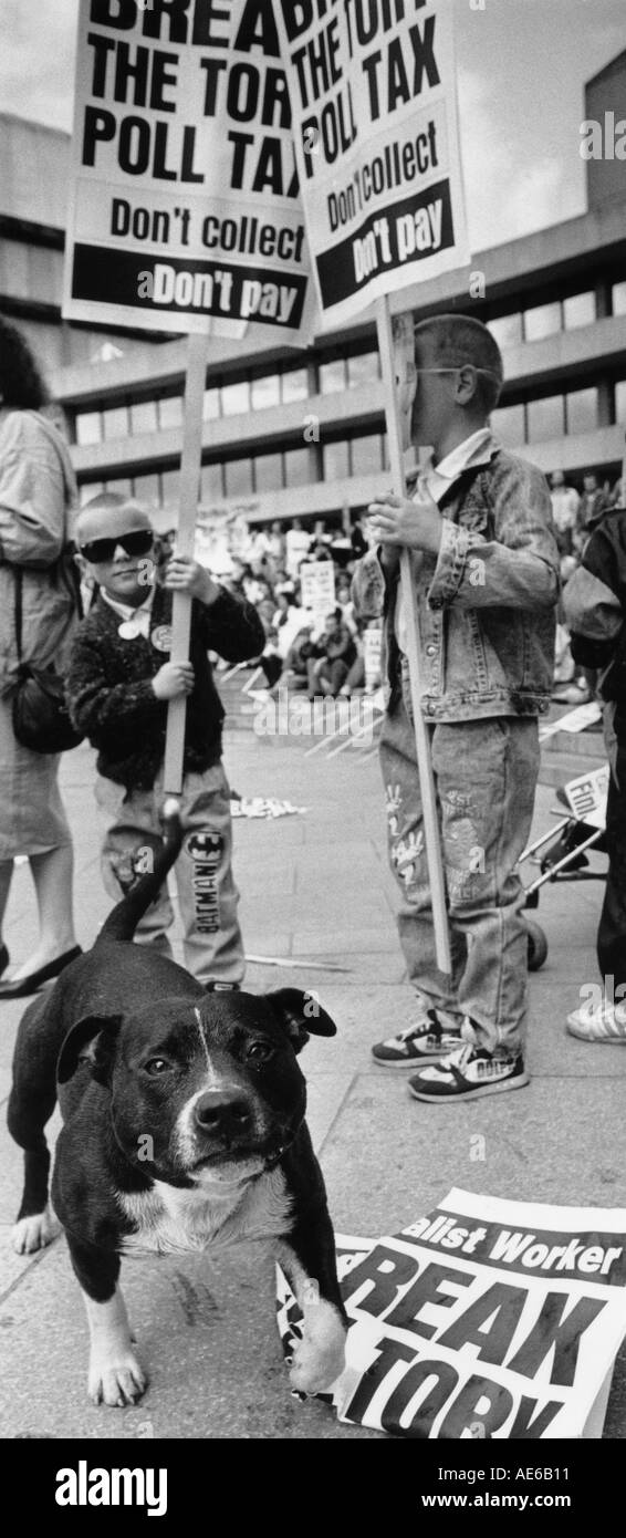 A staffordshire bull terrier dog and young boy on a poll tax demonstration in Birmingham England 1990 - Stock Image