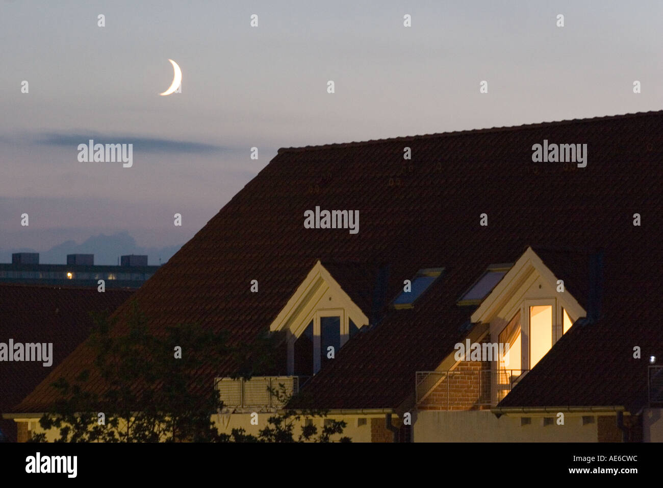 Rooftop apartment in the night with moon - Stock Image