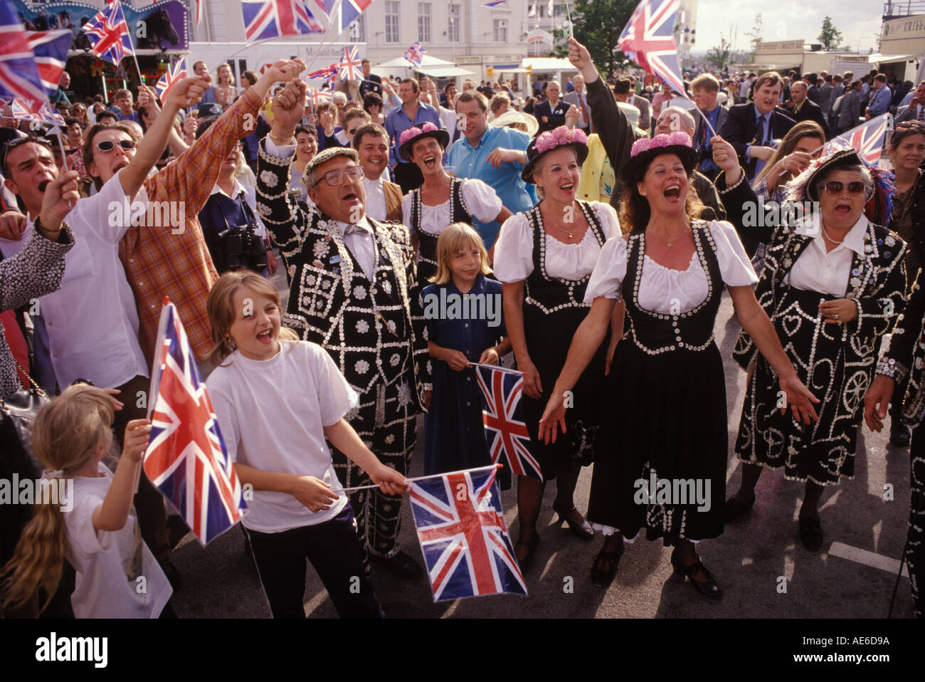 Pearly Kings and Queens at the Derby Horse race singing Rule Britannia Surrey England HOMER SYKES - Stock Image