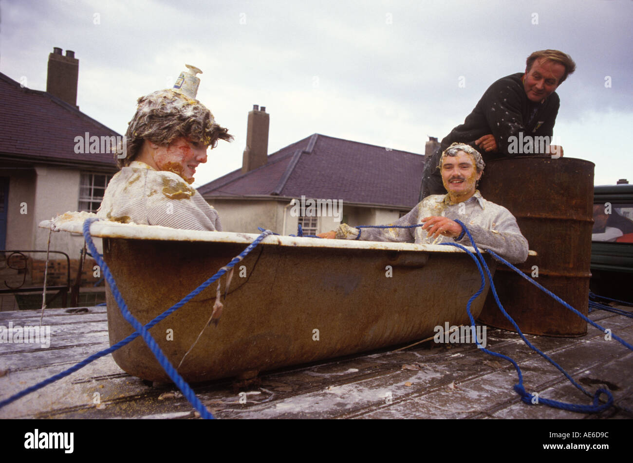 Blackening of the bride and groom, a pre wedding festival Mallaig Scotland UK HOMER SYKES - Stock Image
