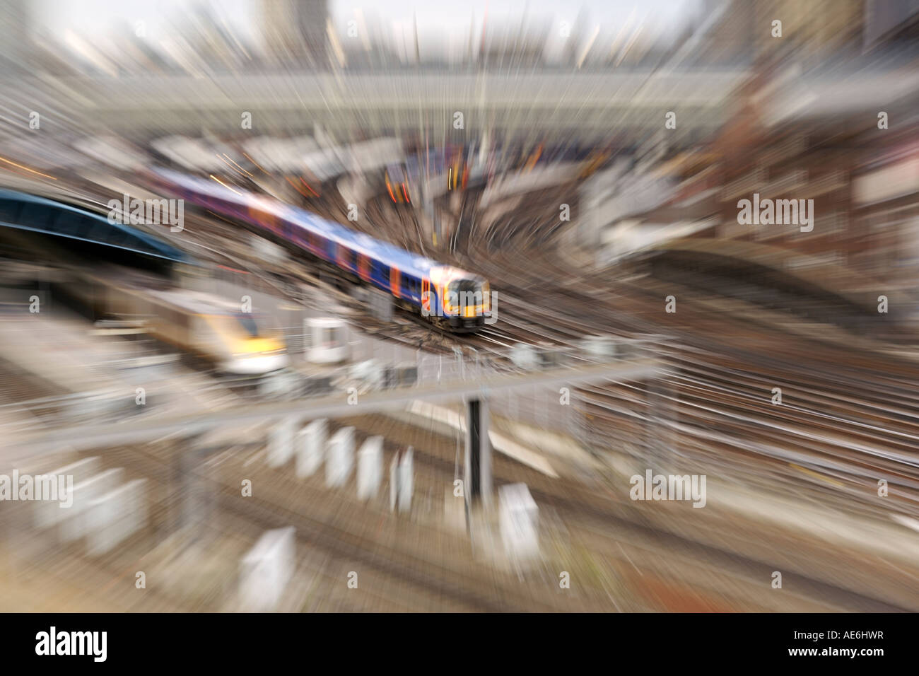 Zoom-blurred view of trains leaving London's Waterloo train station. - Stock Image