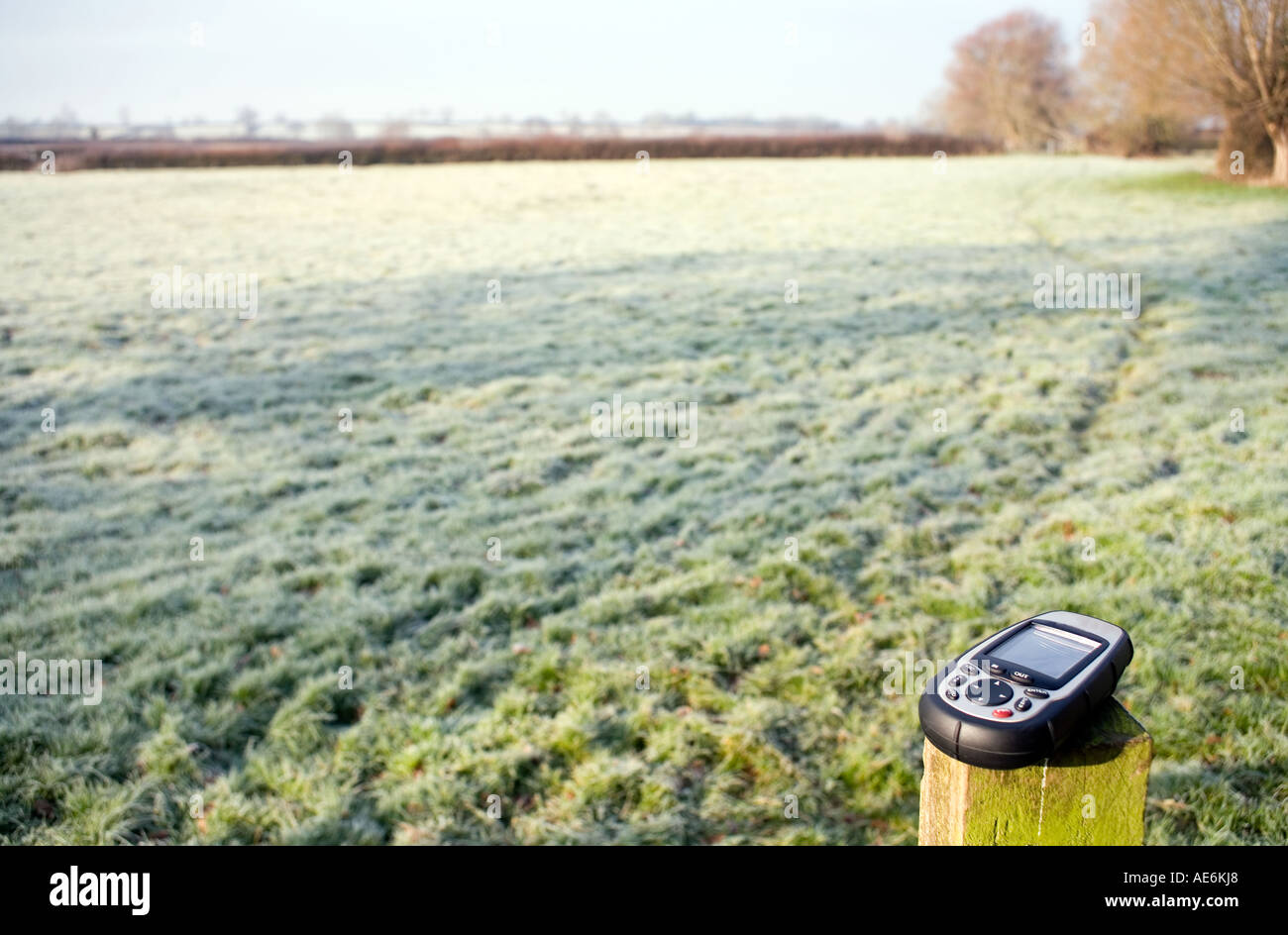 GPS unit on gatepost farmland Somerset GPS unit receiver navigation orienteering frost gate post gatepost cold winter day crisp - Stock Image
