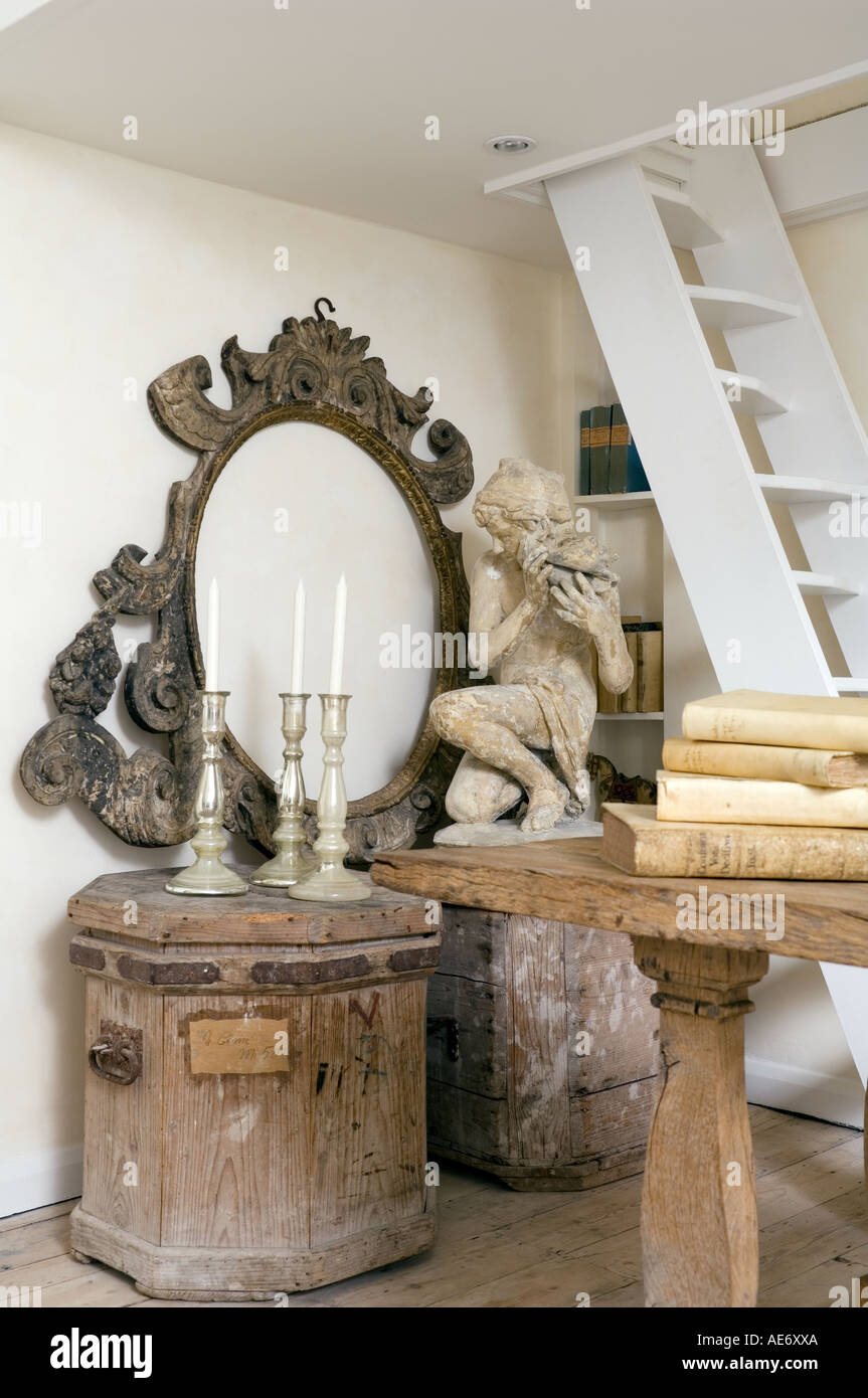 antique mirror frame and furniture in modern interior - Stock Image