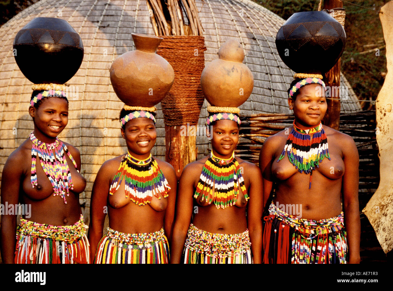 Zulu Shakaland Zulu maidens carrying pots on heads at Shakaland in KwaZulu Natal, South  Africa
