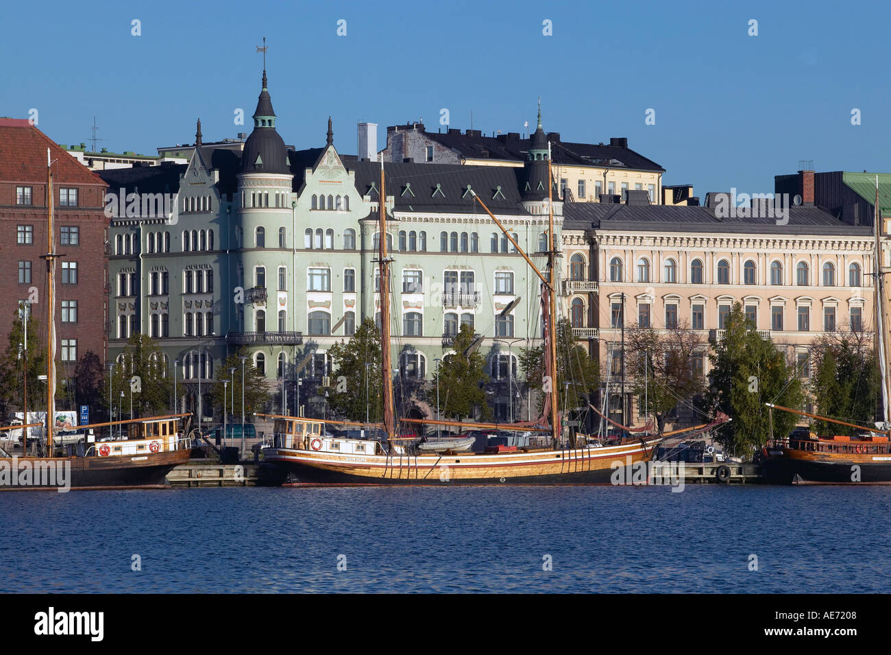 Finland Helsinki view to Pohjoisranta across North harbour with classic sailing ships - Stock Image