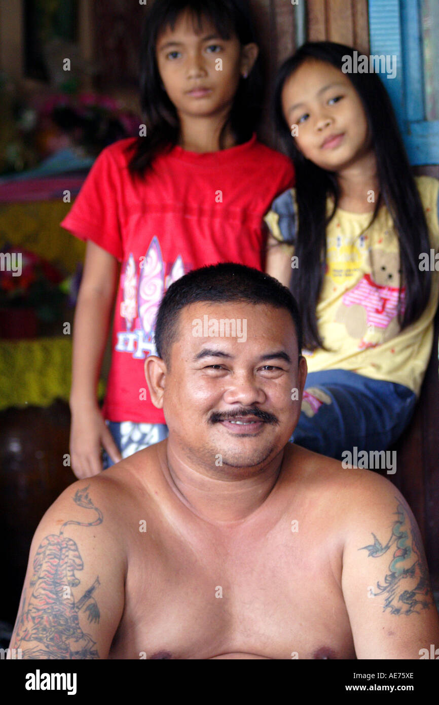 Man With Tattoos And Beautiful Young Girls Rumah Engking A Stock Photo Alamy