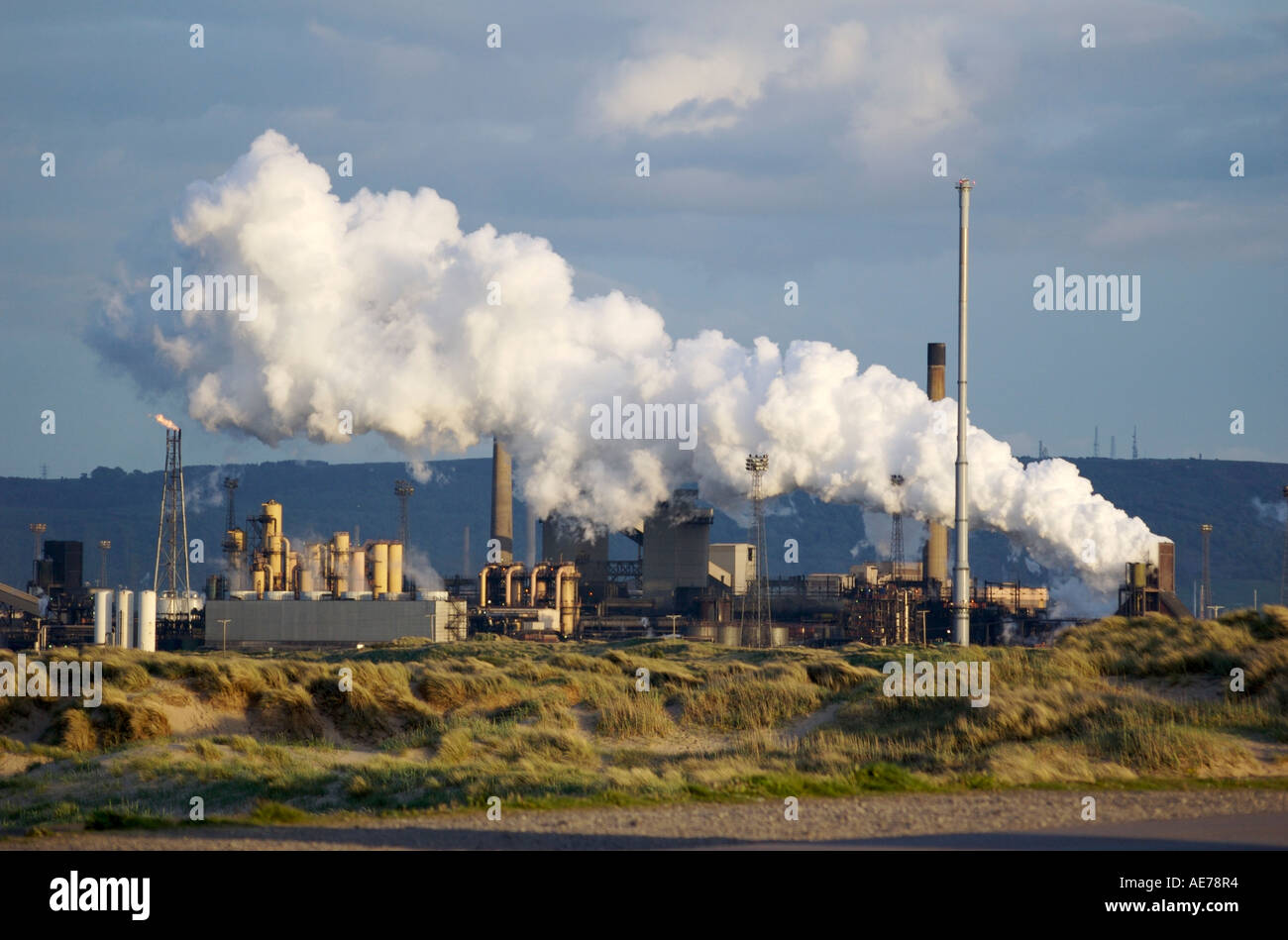 Corus steelworks with gasometer belching steam - Stock Image