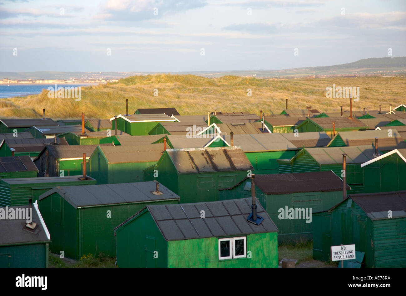 Fishing huts by Corus steelworks - Stock Image