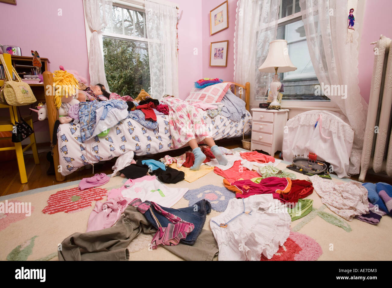 Girl Laying On Bed In Messy Bedroom Stock Photo Alamy