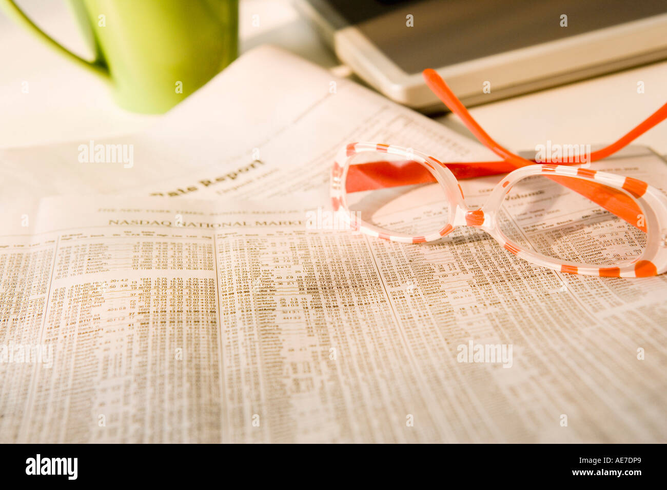 Close up of glasses on stock market paper - Stock Image