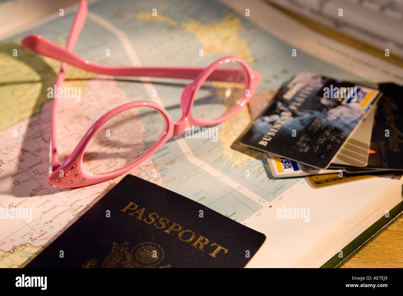 Glasses and passport with map - Stock Image