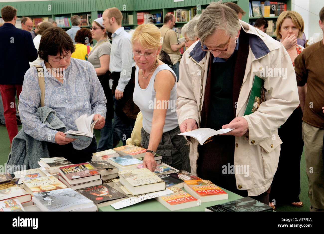Visitors reading and browsing in the bookshop at The Guardian Hay Festival 2006 Hay on Wye Powys Wales UK - Stock Image