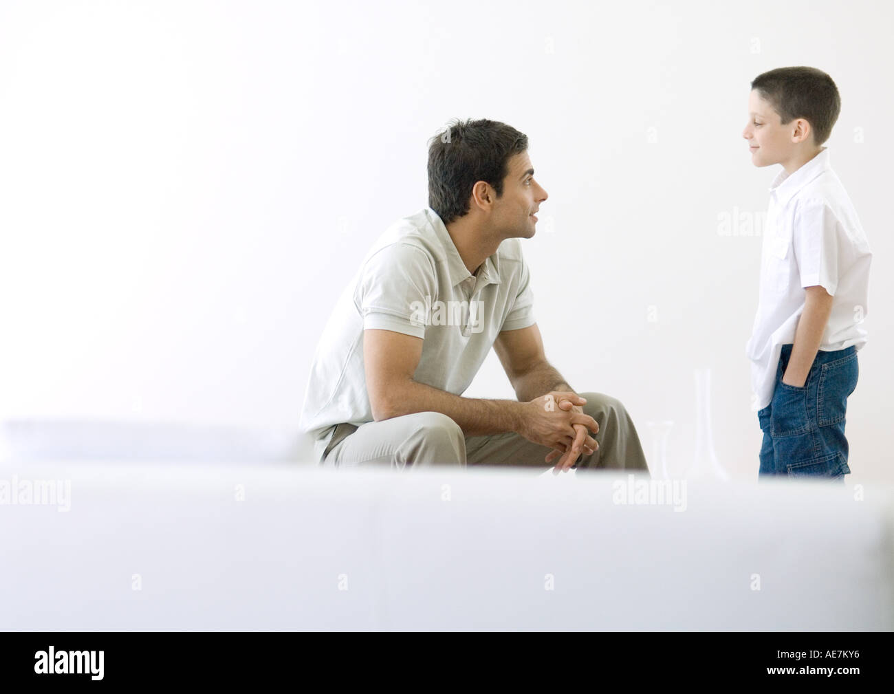 Man having talk with son - Stock Image