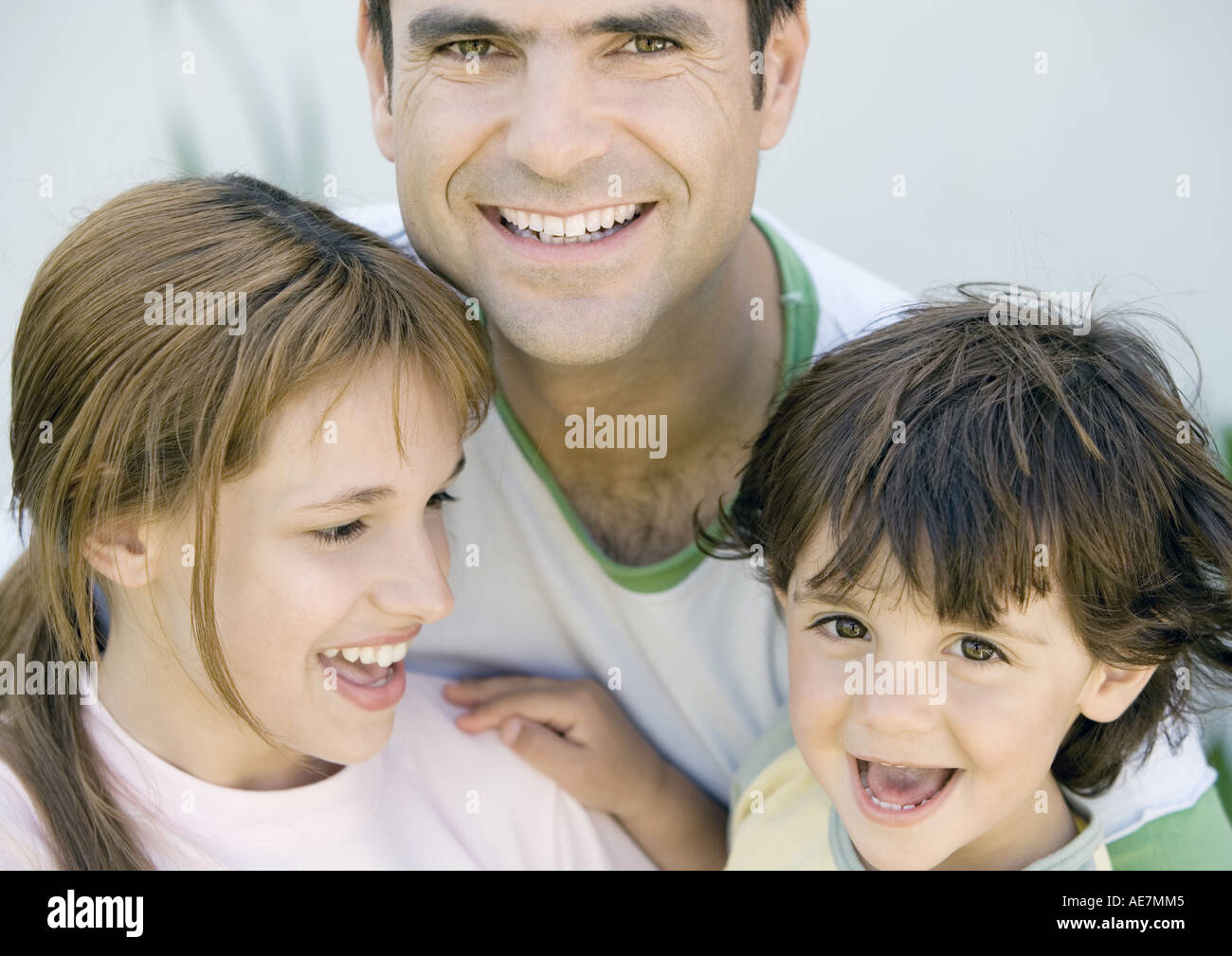 Father with two children, portrait - Stock Image