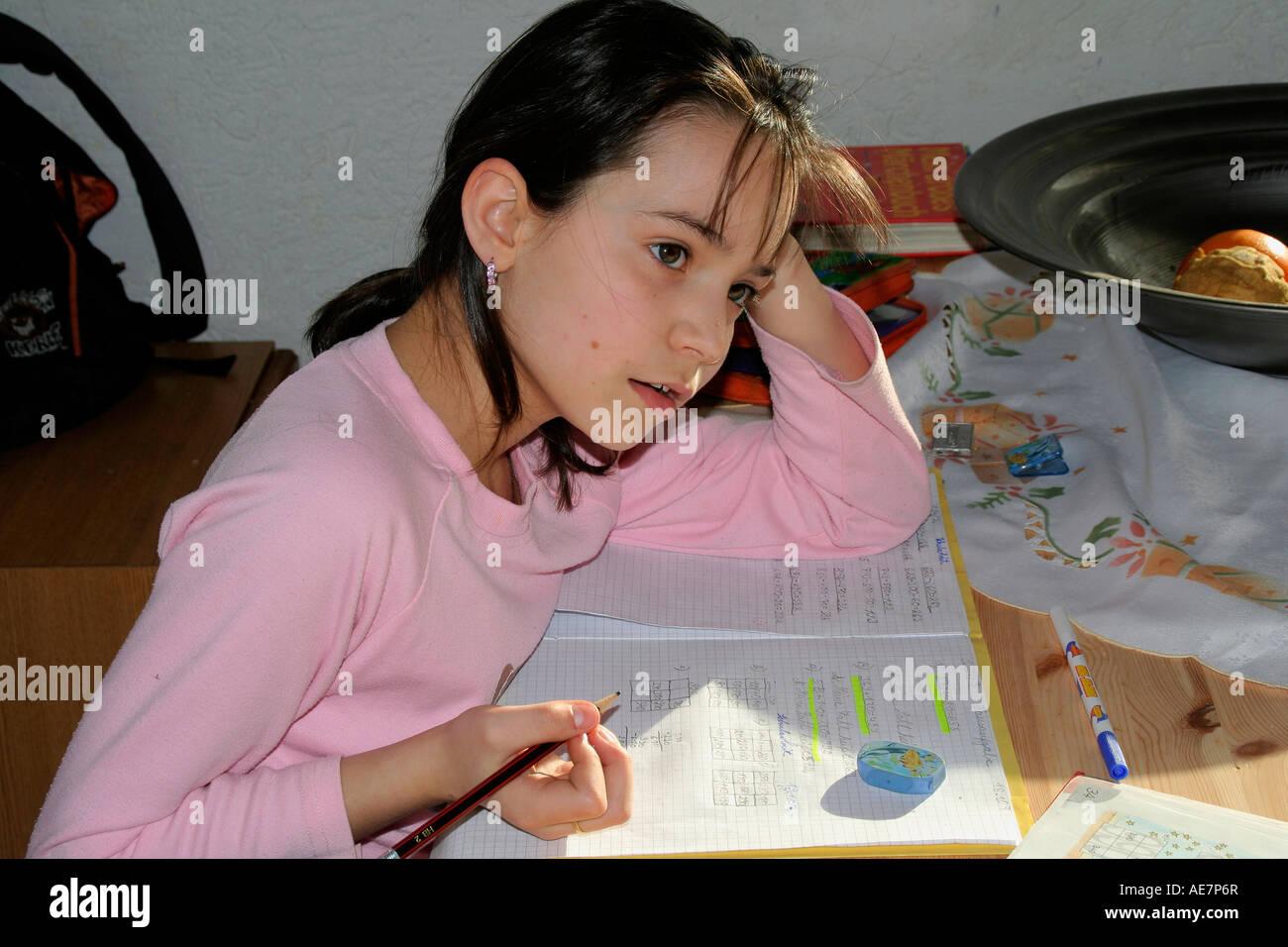 School child with the homework - Schulkind bei den Hausaufgaben Stock Photo