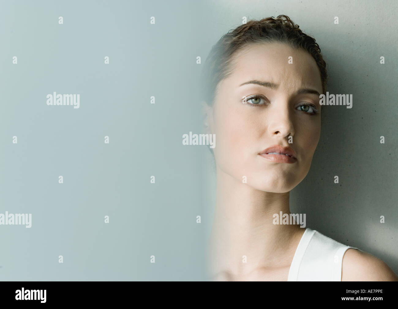 Woman furrowing brow - Stock Image