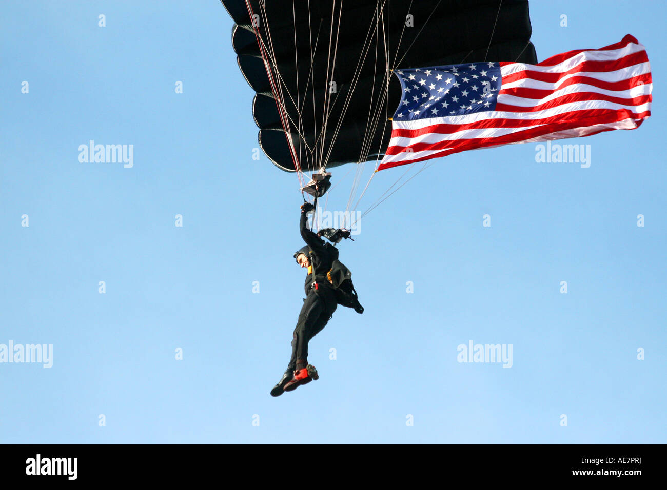 United States Military SOCOM Parachutist with American Flag at MacDill Air Fest in Tampa Florida USA Stock Photo