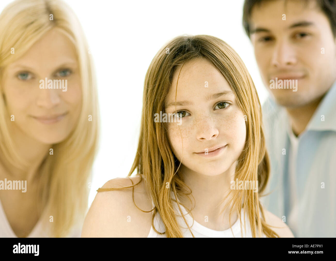 Girl in front of parents, portrait - Stock Image