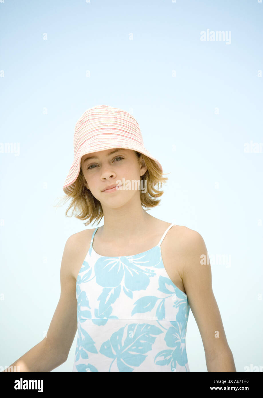Preteen girl wearing sun hat, portrait - Stock Image